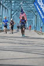 Local runner honors military during half Ironman