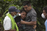 At Guatemala volcano, families left on their own to keep searching