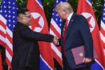 North Korea lauds, and basks in, Kim's summit performance