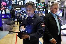 US stocks end turbulent week with broad gains
