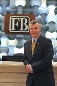 FirstBank expands into Kentucky with purchase of Farmers National