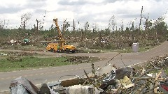 Alexander tours tornado affected areas